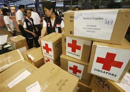 Members of the Singapore Red Cross prepare to leave for Myanmar with S$20,000 ($14,710) worth of medical aid at Singapore's Changi Airport May 23, 2008. REUTERS/Vivek Prakash