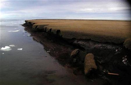 A handout photo from 2004 shows coastal erosion of mud-rich permafrost along on Beaufort Sea coastline Drew Point in Alaska. At risk from surging storm waves and floods, Alaska's coastal villagers are dealing with the immediate consequences of climate change -- threats to their health, safety and even their ancestors' graves. The rapid erosion of the state's coastline is blamed on the scarcity of sea ice and thawing of permafrost. REUTERS/USGS/Gary Clow/Handout