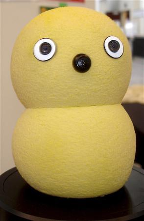 Keepon, a bright yellow, silicon-skinned, snowman-like robot sits on display at the IEEE International Conference for Robotics and Automation in Pasadena, California May 22, 2008. REUTERS/Sjantani Chatterjee