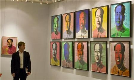 A visitor looks at a ten-piece set paper screenprint of Mao Zedong by Andy Warhol, which is part of Warhol's series of the late Chinese leader, displayed at the Hong Kong Convention and Exhibition Centre during Christie's 2008 Spring Sales May 26, 2008. Christie's sold a record $310.7 million worth of Asian art during the sale this week. REUTERS/Victor Fraile (CHINA)