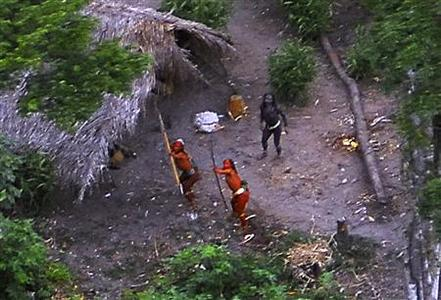 Members of an unknown Amazon Basin tribe and their dwellings are seen during a flight over the Brazilian state of Acre along the border with Peru in this May, 2008 photo distributed by FUNAI, the government agency for the protection of indigenous peoples. Survival International estimates that there are over 100 uncontacted tribes worldwide, and says that uncontacted tribes in the region are under increasing threat from illegal logging over the border in Peru. REUTERS/Funai-Frente de Proteção Etno-Ambiental Envira/Handout