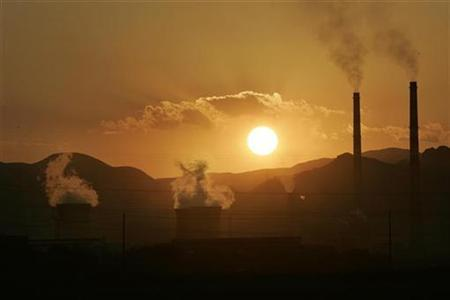 Chimneys are seen in this file photo at an oil refinery in Lanzhou, capital of northwest China's Gansu province, July 23, 2007. Mounting criticism over how some climate policies are adding to record energy and food prices threatens to distract U.N.-led talks on a new global warming pact, which resume this week in Bonn. REUTERS/Aly Song