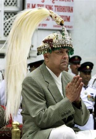 Nepal's new king Gyanendra greets people at the Hanuman Palace in Kathmandu in this June 4, 2001 file photo. In Nepal the monarchy has traditionally been seen as a symbol of national unity, so much of the hatred against it has been blamed on Gyanendra and his playboy son Paras -- known for reckless driving, nightclub brawls and wild living in one of the world's poorest countries. REUTERS/Pawel Kopczynski/Files