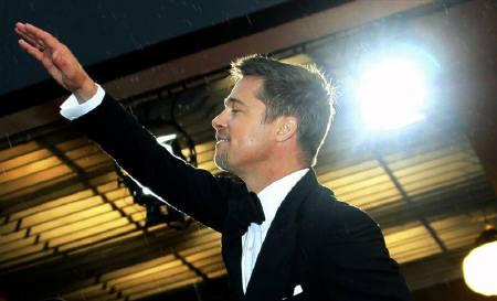 Brad Pitt waves to the public before the screening of ''The Exchange'' by U.S. director Clint Eastwood at the 61st Cannes Film Festival in this May 20, 2008 file photo. REUTERS/Jean-Paul Pelissier
