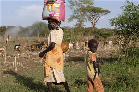 PA Mother And Her Child Flee South From Renewed Fighting In Abyei On Abathok Agok Road This Picture Made Available By The United Nations Mission
