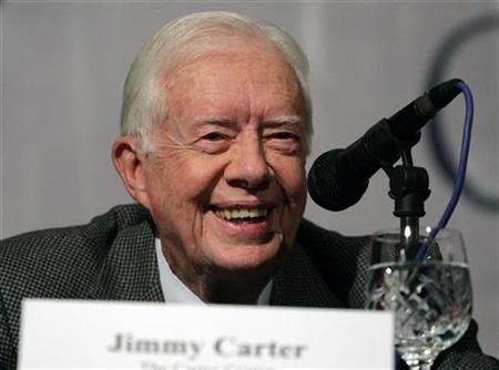 Former President Jimmy Carter talks to the media in Kathmandu, Nepal, April 12, 2008. Carter will endorse Sen. Barack Obama as the Democratic nominee for president when polls close in two primaries later on Tuesday, the Carter Center in Atlanta said. REUTERS/Shruti Shrestha