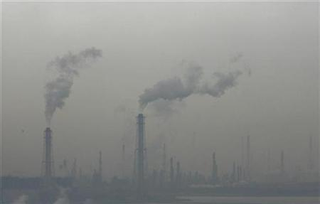 Smoke is emitted from a factory area in Chiba, east of Tokyo, March 14, 2008. REUTERS/Toru Hanai