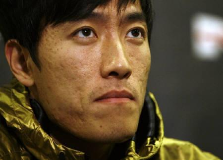 Liu Xiang, Chinese track and field star and Olympic gold medallist, listens to a question during a news conference at the Empire State Building in New York May 28, 2008. REUTERS/Shannon Stapleton