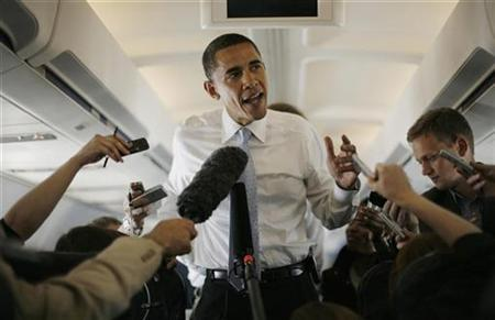 Presumptive Democratic presidential nominee Senator Barack Obama (D-IL) speaks to the media en route to Dulles Airport in Virginia, June 5, 2008. Obama is campaigning on the outskirts of Washington in Bristow, Virginia. REUTERS/Jason Reed