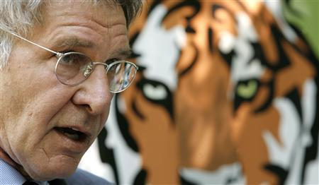 Actor Harrison Ford speaks at the launch of the Tiger Conversation Initiative at the National Zoo in Washington June 9, 2008. The initiative, backed by the World Bank and a coalition of partners, is aimed at protecting the tiger population and their habitat. REUTERS/Kevin Lamarque