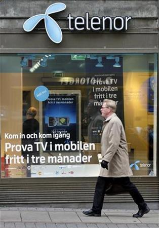 A pedestrian walks past a Telenor store in central Stockholm October 26, 2007. REUTERS/Bob Strong