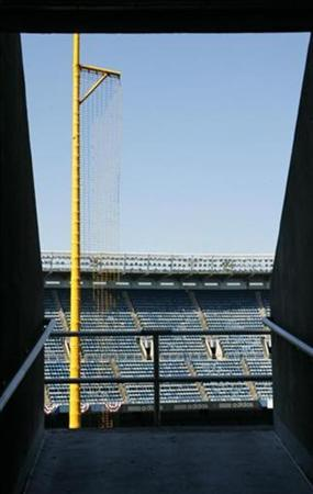 The foul pole in Yankee Stadium is framed by a rampway as it waits for opening day where the New York Yankees and the Toronto Blue Jays will play in New York March 30, 2008. REUTERS/Ray Stubblebine