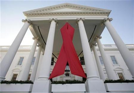 An AIDS ribbon hangs from the North Portico of the White House on World AIDS Day, November 30, 2007. Researchers have been undercounting new cases of HIV infection in the United States, meaning the rate is probably 25 percent higher at 50,000 people per year, the nation's top AIDS doctor said on Tuesday. REUTERS/Yuri Gripas