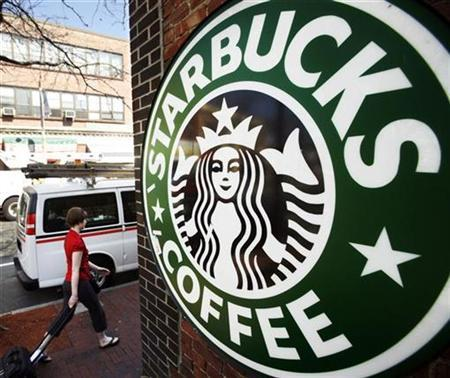 A woman walks past a Starbucks store in Somerville, Massachusetts in this file photo from April 24, 2008. REUTERS/Brian Snyder