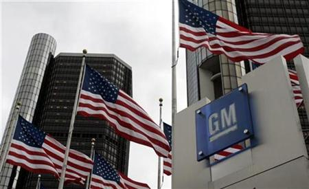 American flags flutter in the wind in front of the General Motors Corp. headquarters in downtown Detroit, Michigan in this file photo from November 7, 2007. GM said on Wednesday it was partnering with Clean Energy Fuels Corp on a new hydrogen refueling station in Los Angeles that the companies hope will be the first of many.REUTERS/Rebecca Cook