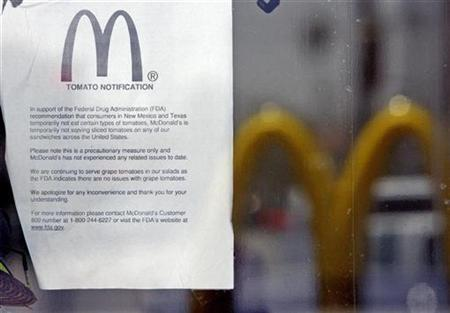 A notice informing customers about not serving tomatoes is on display at a McDonald's restaurant in Los Angeles, June 10, 2008. U.S. health officials on Wednesday said they are still receiving reports of people falling ill from eating Salmonella-tainted tomatoes and that they now have 167 reported cases from 17 states. REUTERS/Mario Anzuoni