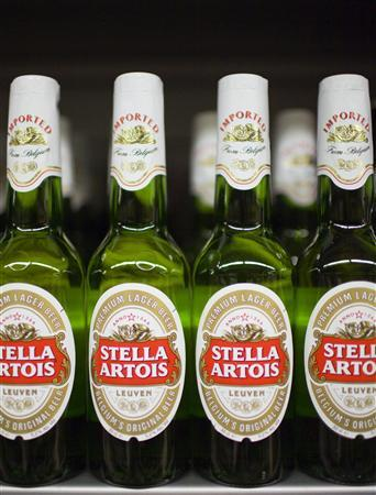 Bottles of Stella Artois beer, a brand of InBev, for sale at a store in Hong Kong's Sheung Wan district, June 12, 2008. REUTERS/Victor Fraile