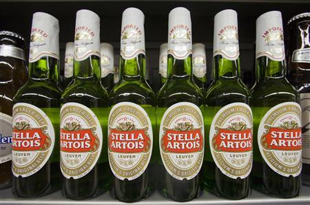 Bottles of Stella Artois beer, a brand of InBev, are displayed for sale at a store in Hong Kong's Sheung Wan district June 12, 2008. InBev NV has offered to buy Anheuser-Busch Cos Inc for $46.3 billion (23.5 billion pounds), as it seeks to create the world's largest brewer with the biggest ever takeover of an alcoholic drinks company. REUTERS/Victor Fraile