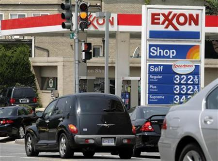 A sign displays prices at a gas station in Washington July 27, 2006. REUTERS/Yuri Gripas
