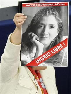 A member of the European Parliament holds up a poster of kidnapped former Colombian presidential candidate Ingrid Betancourt during a debate at the European Parliament in Strasbourg March 12, 2008. REUTERS/Vincent Kessler