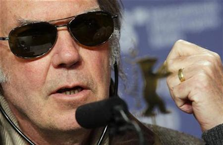 Neil Young addresses a news conference to present the film 'CSNY: Deja Vu' running at the 58th Berlinale International Film Festival in Berlin February 8, 2008. REUTERS/Hannibal Hanschke