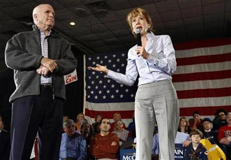Republican presidential candidate Senator John McCain (L) stands while Carly Fiorina, former chairman and chief executive officer of Hewlett-Packard, speaks during a campaign event in Warren, Michigan in this January 12, 2008 file photo. REUTERS/Shannon Stapleton