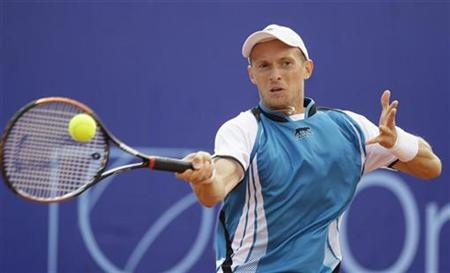 Nikolay Davydenko of Russia hits a return to Tommy Robredo of Spain during the final of the Orange Warsaw Open tennis tournament in Warsaw, June 15, 2008. REUTERS/Peter Andrews