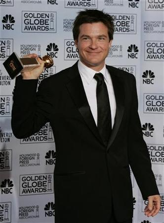 Jason Bateman poses with his award won for best actor in musical or comedy series for his role in ''Arrested Development,'' at the 62nd annual Golden Globe Awards at the Beverly Hilton in Beverly Hills, California January 16, 2005. REUTERS/Mike Blake