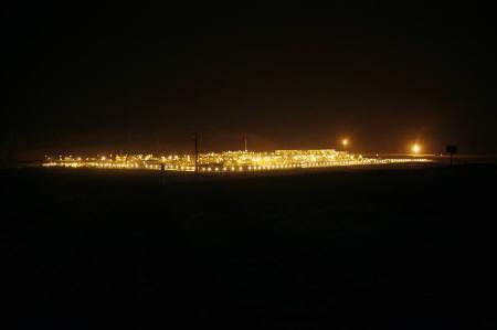 An oilfield complex is seen at night in the Rub' al-Khali desert, Saudi Arabia, November 14, 2007. REUTERS/ Ali Jarekji