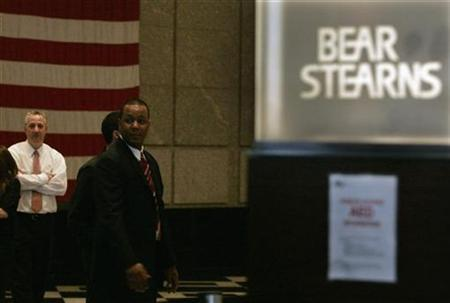 Employees of Bear Stearns watch as demonstrators from the Neighborhood Assistance Corporation of America protest inside the Bear Stearns headquarters lobby in New York March 26, 2008. REUTERS/Shannon Stapleton