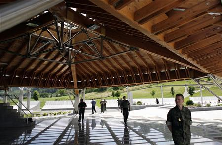 EUFOR peacekeepers in Bosnia visit a memorial for victims of the Srebrenica massacre, in Potocari, June 16, 2008. REUTERS/Damir Sagolj
