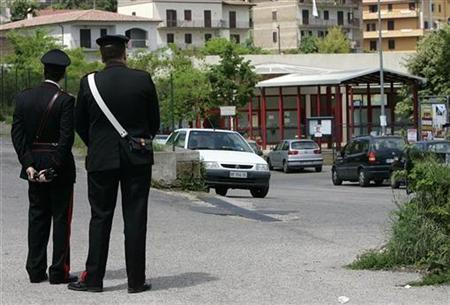 Carabinieri military police patrol the entrance of the ''Olga Rovere'' nursery school at Rignano Flaminio, 25 miles north of Rome, May 11, 2007. REUTERS/Max Rossi