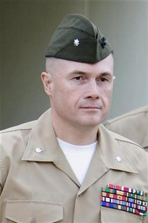 In this file picture, United States Marine Corps Lieutenant Colonel Jeffrey Chessani walks towards his arraignment on charges of dereliction of duty and violation of a lawful order at USMC Camp Pendleton in Oceanside, California November 16, 2007. A military judge on Tuesday dismissed the charges against a U.S. Marine officer accused of failing to investigate the death of two dozen civilians at Haditha, lawyers in the case said. REUTERS/Fred Greaves