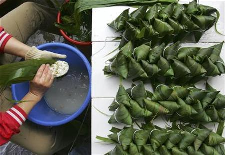 A worker makes Zongzi (rice dumplings), a traditional Chinese dish made from rice wrapped in bamboo leaves, at a market in Yiliang County of Kunming, Yunnan province June 6, 2008. REUTERS/Stringer