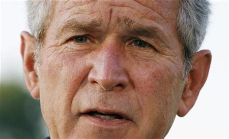 President George W. Bush speaks to reporters upon his departure from Washington en route to Europe June 9, 2008. REUTERS/Kevin Lamarque