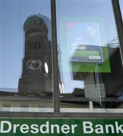Munich's landmark Frauenkirche (womens church) is reflected in a window of the Munich branch office of Dresdner Bank February 19, 2008. REUTERS/Michael Dalder