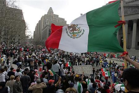 A man waves a Mexican flag during a rally in New York April 1, 2006. REUTERS/Seth Wenig