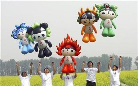 Fuwa-shaped balloons are flied during a tourism festival in Beijing May 23, 2008. REUTERS/China Daily