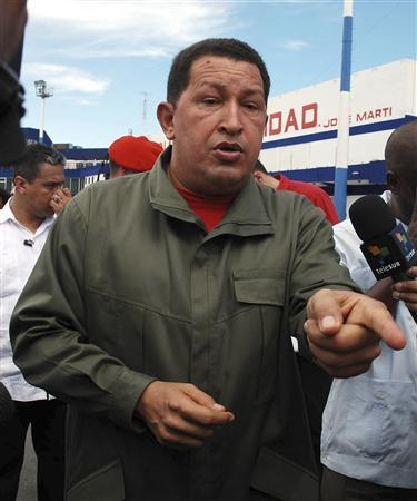 Venezuela's President Hugo Chavez talks to the media upon his arrival at Havana's Jose Marti airport June 16, 2008. REUTERS/AIN/Sergio Abel Reyes