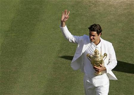 In this file photo Switzerland's Roger Federer holds the trophy after winning his men's final match against Spain's Rafael Nadal at the Wimbledon tennis championships in London, July 8, 2007. REUTERS/Alex Livesey/Pool