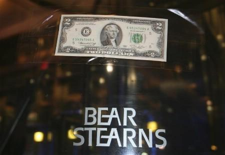 A U.S. two dollar bill is taped to the revolving door leading to the Bear Stearns global headquarters in New York March 17, 2008. REUTERS/Kristina Cooke