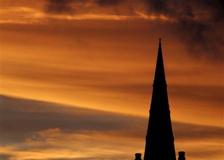 The steeple of St. Paul's Anglican Church is silhouetted against the sky at sunset in Valletta, Malta, February 14, 2007. REUTERS/Darrin Zammit Lupi