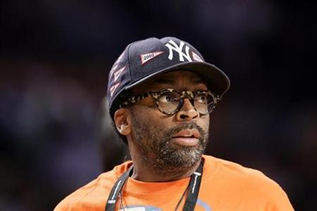 Director Spike Lee watches the Los Angeles Lakers play the Boston Celtics in Game 3 of the NBA Finals basketball championship in Los Angeles, June 10, 2008. REUTERS/Jeff Haynes