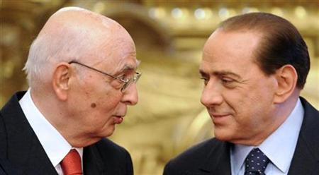 Italy's Prime Minister Silvio Berlusconi speaks to President Giorgio Napolitano (L) during his swearing-in ceremony at the Quirinale palace in Rome, May 8, 2008. REUTERS/Chris Helgren