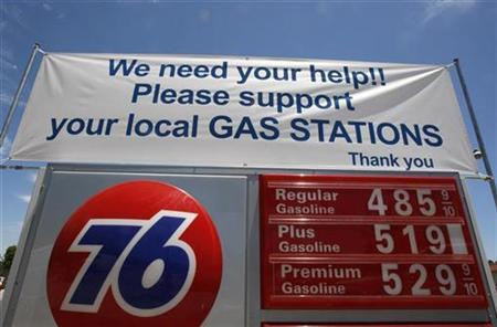 A gas station in Los Angeles displays a sign asking for business from its customers in Los Angeles, June 19, 2008. REUTERS/Lucy Nicholson