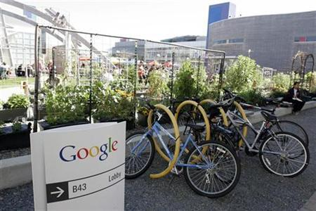 Employees use community bikes to travel around Google headquarters in Mountain View, California March 3, 2008. REUTERS/Erin Siegal