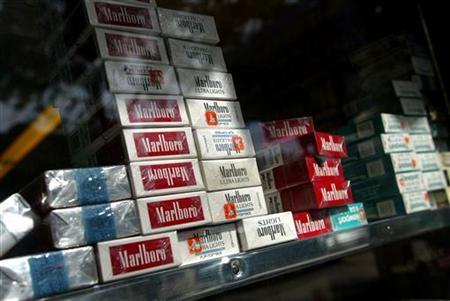Packs of cigarettes are stacked inside a supermarket in New York September 21, 2004.REUTERS/Shannon Stapleton