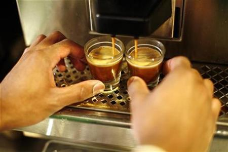 A barista makes espresso during training at a coffee shop in New York, February 26, 2008. REUTERS/Keith Bedford/Handout