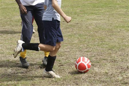 A boy is seen during a soccer practice in an undated photo. Parents who succumb to fits of road rage are also more likely to blow a fuse at their children's sporting events, according to U.S. research. REUTERS/File