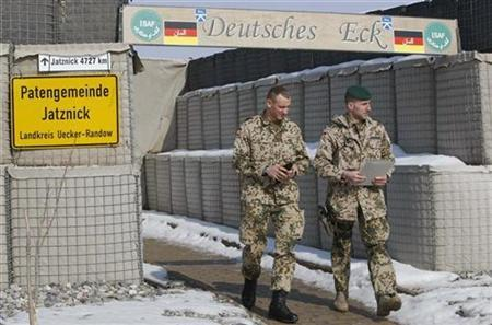 German armed forces ISAF soldiers walk inside their base camp in the northern Afghan city of Kunduz January 30, 2008. REUTERS/Fabrizio Bensch